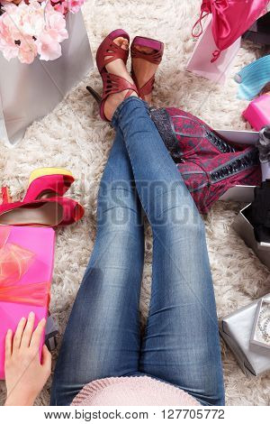 Fashion lover trendy woman relaxing at home after shopping