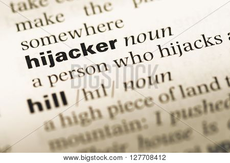 Close Up Of Old English Dictionary Page With Word Hijacker.