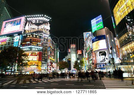 Tokyo, Japan - Nov 25: Pedestrians cross at Shibuya Crossing on November 25 th in Tokyo, Japan, 2015 . Shibuya Crossing is one of the busiest crosswalks in the world.