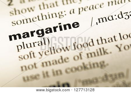 Close Up Of Old English Dictionary Page With Word Margarine.