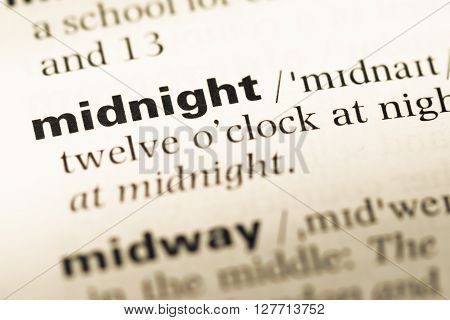 Close Up Of Old English Dictionary Page With Word Midnight.