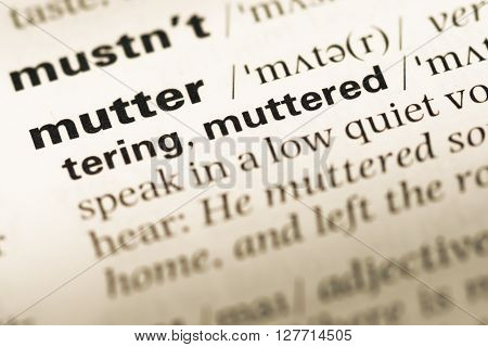 Close Up Of Old English Dictionary Page With Word Mutter.