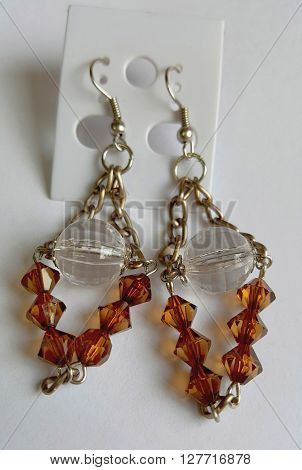Brown plastic bead with chain drop earrings