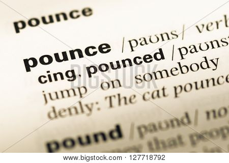 Close Up Of Old English Dictionary Page With Word Pounce.