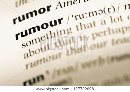 Close Up Of Old English Dictionary Page With Word Rumour.