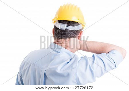 Stressed engineer feeling back neck pain. Medical insurance concept