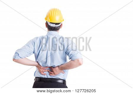 Engineer or architect feeling lower back pain after a long work day