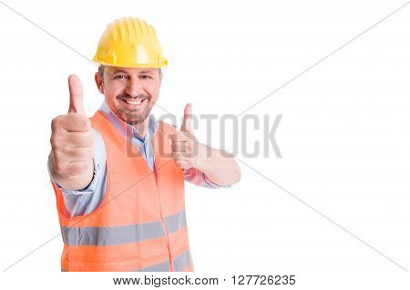 Happy constructor smiling and showing thumbs up on white copy space