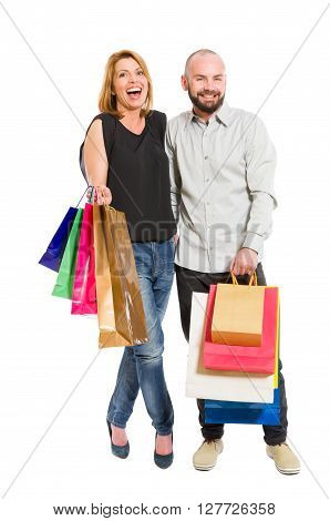 Young shopping couple or boyfriend and girlfriend standing on white background