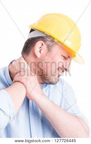 Hardhat builder or architect back neck pain concept on white background