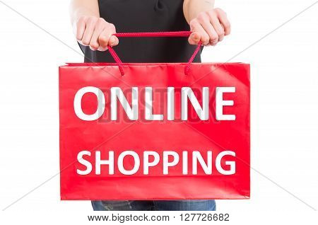 Online shopping concept with a woman holding a red paper gift bag