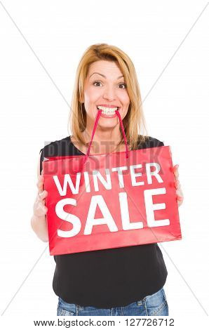 Shopping woman holding a gift bag with winter sale text