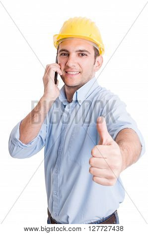 Confident Engineer Showing Thumb Up While Talking On Phone