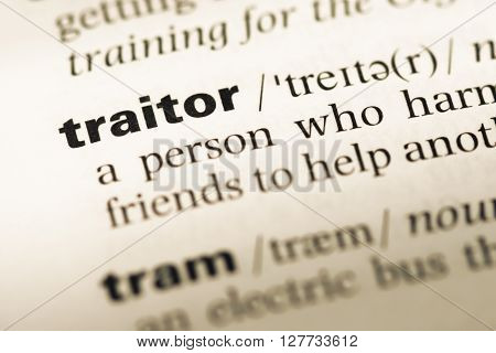 Close Up Of Old English Dictionary Page With Word Traitor.