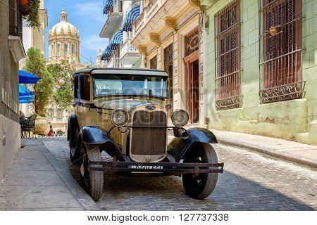 HAVANA,CUBA- APRIL 26,2016 : Beautifully restored classic Ford Model T car parked on a cobblestone street in Old Havana