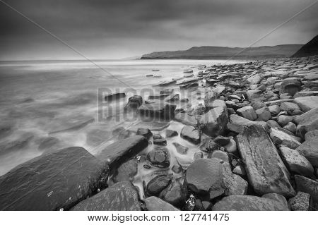 Cloudy Kimmeridge Bay Dorset England in black and white