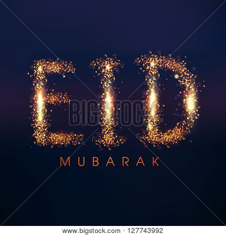 Glowing golden sparkling text Eid Mubarak on blue background for Muslim Community Festival celebration.