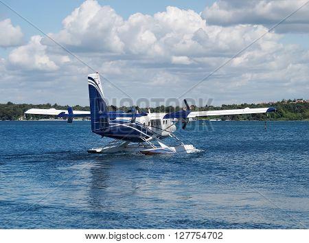 seaplane prepare for take off, back side view