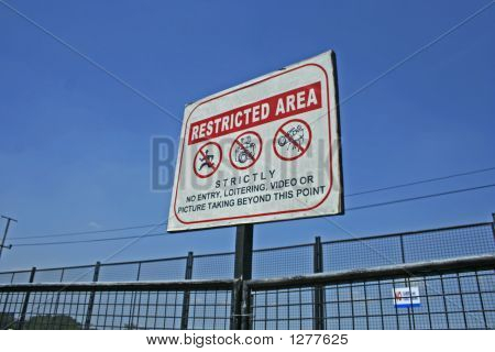 the restricted area sign on the gate. poster