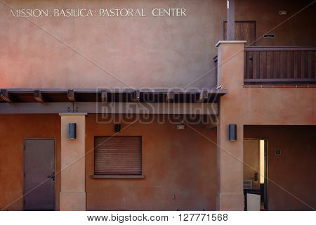 SAN JUAN CAPISTRANO, UNITED STATES - DECEMBER 25, 2015: The clay colored and plain facade in the courtyard of the Mission Basilica San Juan Capistrano in Adobe style on December 25, 2015 in San Juan Capistrano.