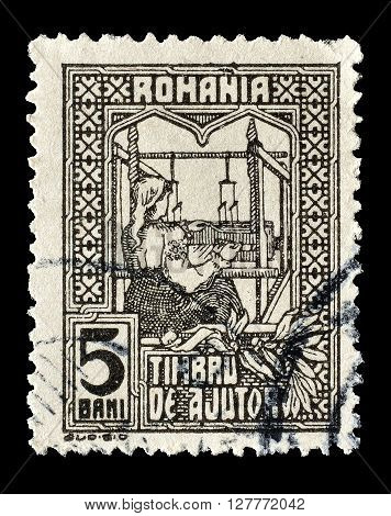 ROMANIA - CIRCA 1916 : Cancelled postage stamp printed by Romania, that shows The queen weaving.
