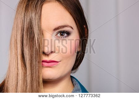 Skincare and cosmetics. Young woman with natural makeup hair cover face eye.