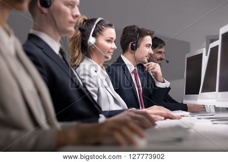 Picture of telemarketers selling their products over the phone