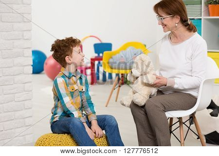Therapist Working With Autistic Kid