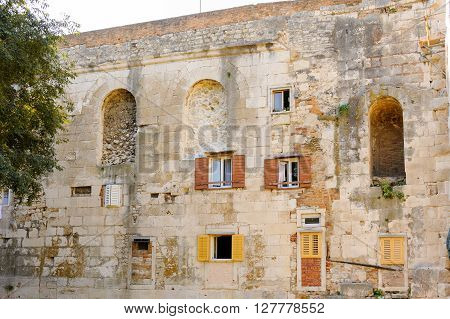 SPLIT CROATIA - SEPTEMBER 2 2009: Houses have assimilated the north city walls next to the Golden Gate (Porta Aurea)
