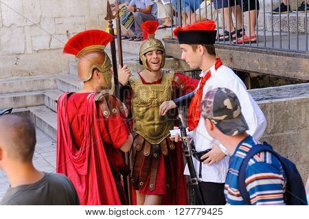 SPLIT CROATIA - SEPTEMBER 2 2009: Roman soldiers next to the entrance to the Vestibule at the east side of the Peristyle under the Prothyron
