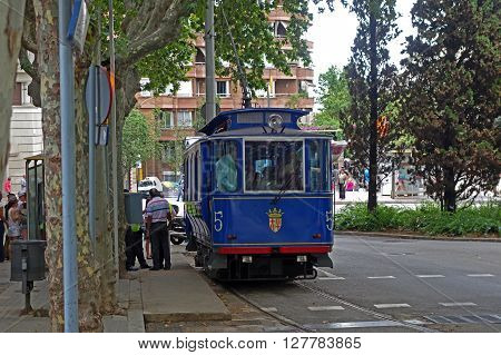 BARCELONA, SPAIN - AUGUST 1, 2015: Famous and one of the oldest in the world streetcar Tramvia Blau in Barcelona, Spain