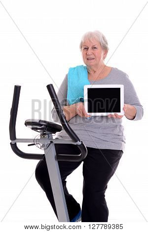 Female Senior Train With Fitness Machine And Showing Tablet Pc