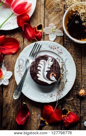 chocolate Sponge Cake.freshly baked brownie-type sponge cake with chocolate. sauce. photo of delicious chocolate cake on wooden table