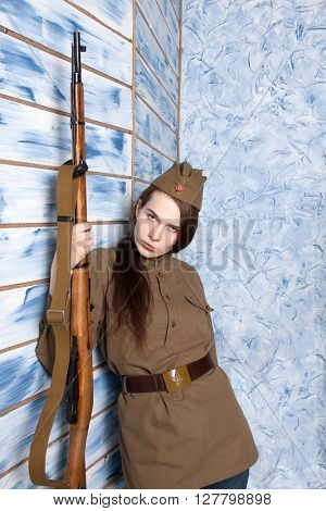 Woman in Russian military uniform with rifle. Female soldier during the second world war.