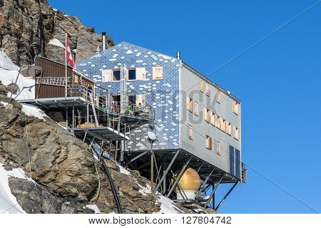 Jungfraujoch Switzerland - December 28 2015 - People taking rest at Monchsjoch mountain hut on Jungfraujoch Switzerland.
