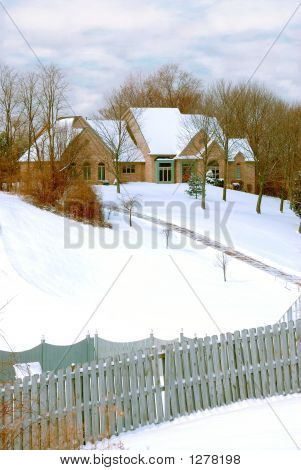 Mansion On A Snow Covered Hillside