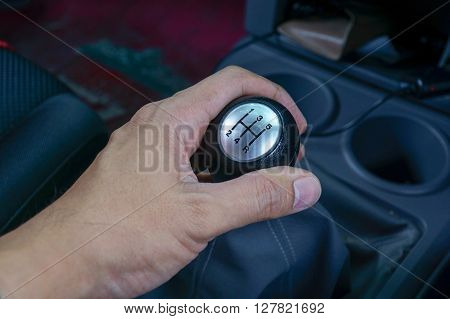 Left Hand Holding A Gear Shift Lever