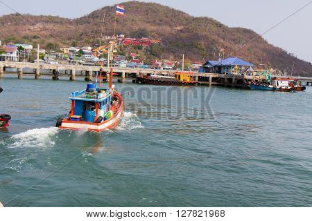 Small fishing and passenger shipsboats Pier background