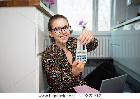 Girl With A Calculator And Credit Card