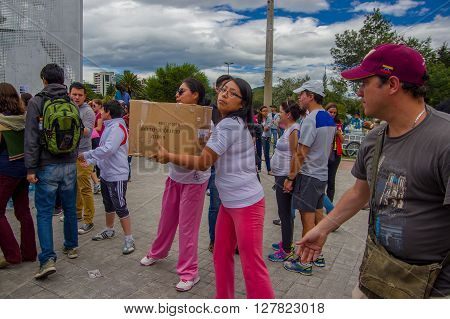 Quito, Ecuador - April, 17, 2016: Unidentified citizens of Quito providing disaster relief food, clothes, medicine and water for earthquake survivors in the coast.