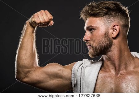 Handsome Young Bodybuilder, Flexes Biceps