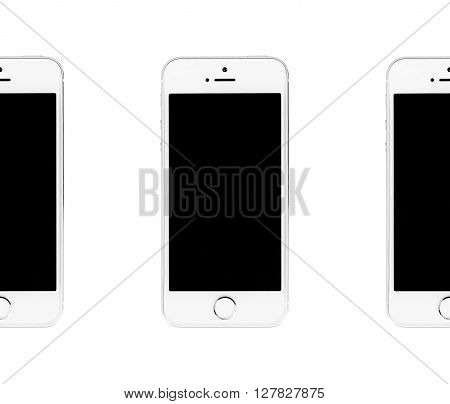 Minsk, Belarus - April 16, 2016: Three Apple iPhone 5S seamless Photo. The operating system iOS 9. The founders of the company: Steve Jobs, Ronald Wayne, Steve Wozniak. Apple Inc. Located in USA.