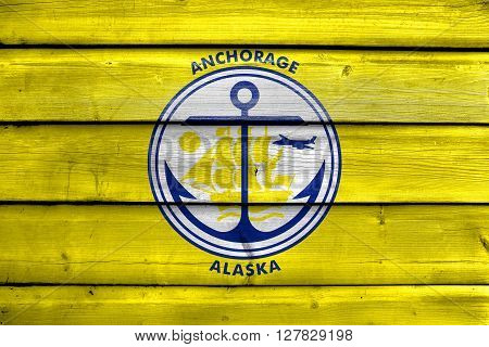 Flag Of Anchorage, Alaska, Painted On Old Wood Plank Background