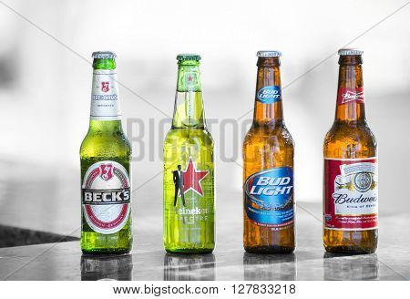 Key West, Florida, USA - January 08, 2016: Popular four bottle of assorted cold beers including Becks, Heineken Spectre, Bud Light and Budweiser. illustrative-editorial image
