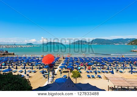 LERICI ITALY - JULY 10 2014: The Lido di Lerici beach crowded with bathers on a sunny day in july. Beach near the village of Lerici in the Gulf of La Spezia Liguria Italy