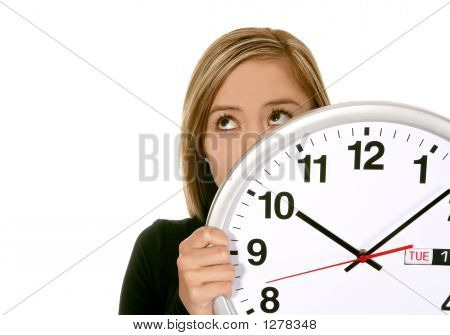 a pretty business woman hiding behind a clock poster