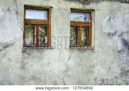 Two old windows in the old farmhouse.