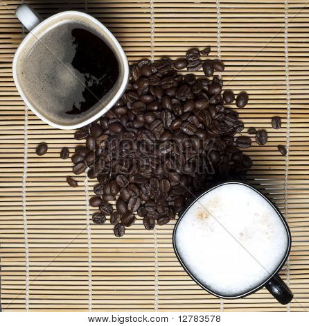 Two coffee cups and coffee beans