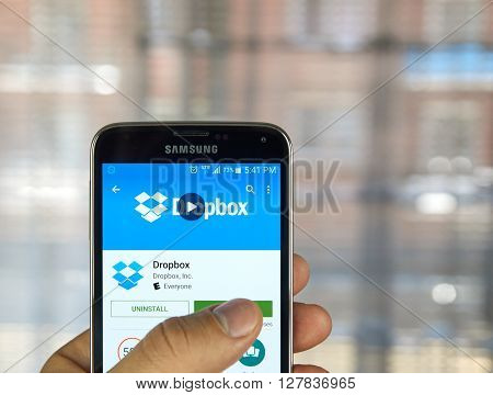 MONTREAL CANADA - APRIL 7 2016 : Dropbox application on a cell phone. Dropbox is a file hosting service operated by Dropbox Inc.