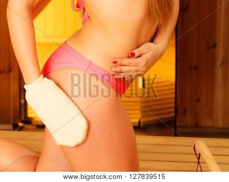 Young Woman In Sauna With Glove